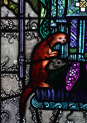 Otter at the feet of St Cuthbert